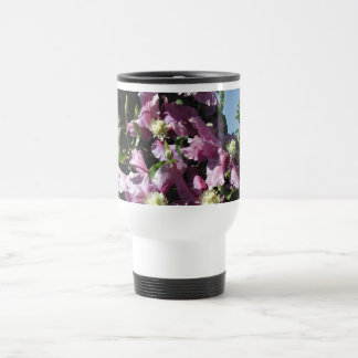 Clematis. Pink Flowers, and blue sky. Coffee Mug