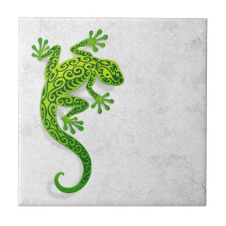 Climbing Green Gecko on a White Wall Tile
