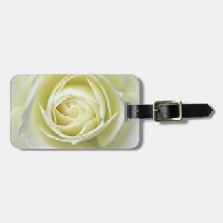 Close up details of white rose luggage tag