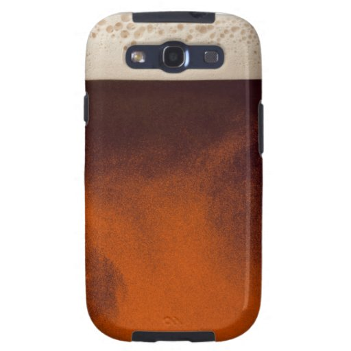 Close up image of amber colored beer with frothy samsung galaxy SIII covers