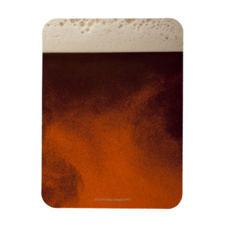 Close up image of amber colored beer with frothy rectangular photo magnet