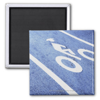 Close-up of a bicycle sign on the road square magnet