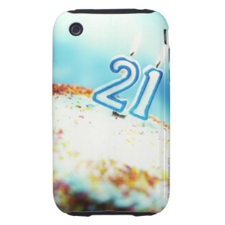 close-up of a birthday cake with a 21 candle on tough iPhone 3 cover
