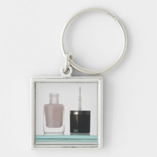 Close-up of a bottle of nail polish Silver-Colored square key ring