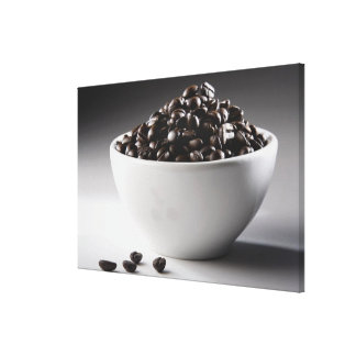 Close-up of a bowl full of coffee beans canvas print