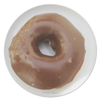 Close-up of a chocolate doughnut on a plate