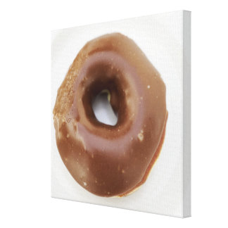 Close-up of a chocolate doughnut on a plate canvas print