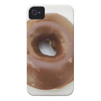 Close-up of a chocolate doughnut on a plate iPhone 4 covers