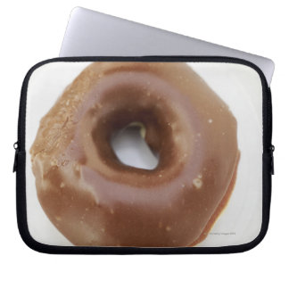Close-up of a chocolate doughnut on a plate laptop sleeve