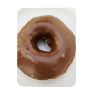 Close-up of a chocolate doughnut on a plate magnet