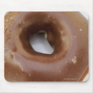 Close-up of a chocolate doughnut on a plate mouse mat