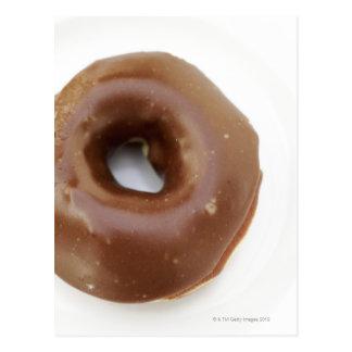 Close-up of a chocolate doughnut on a plate postcard