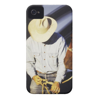 Close-up of a cowboy tying a rein iPhone 4 cover