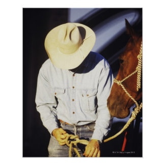 Close-up of a cowboy tying a rein poster