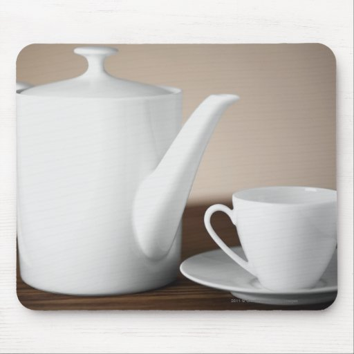 Close-up of a cup and a saucer with a tea kettle mouse pads