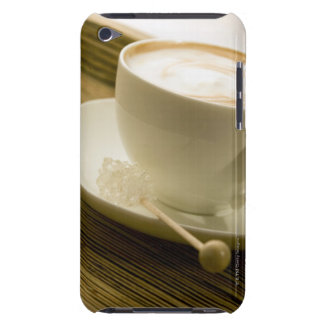 Close-up of a cup of coffee with a candy Case-Mate iPod touch case