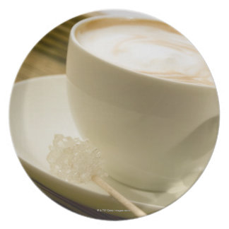Close-up of a cup of coffee with a candy plate