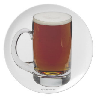 Close up of a glass of beer 3 dinner plate