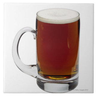 Close up of a glass of beer 3 tile