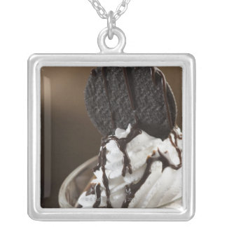 Close-up of a glass of chocolate sundae silver plated necklace