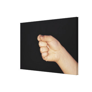Close-up of a hand with fist clenched canvas print