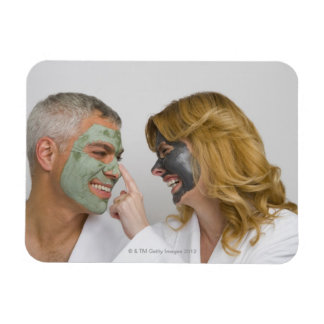 Close-up of a mature couple wearing facial masks magnets
