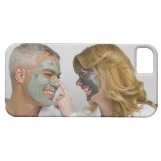 Close-up of a mature couple wearing facial masks iPhone 5 cover