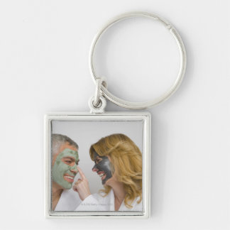 Close-up of a mature couple wearing facial masks key chains