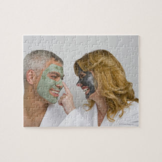 Close-up of a mature couple wearing facial masks puzzle