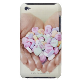 Close-up of a Person Holding a Pile of iPod Case-Mate Case