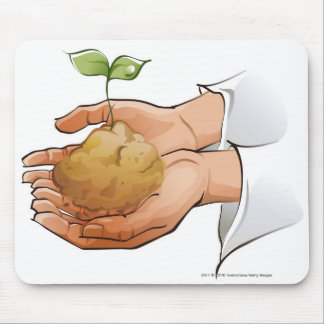 Close-up of a person's hands holding seedling mouse mat