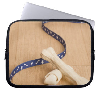 Close-up of a pet collar and a leash with dog laptop sleeve