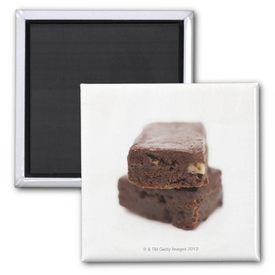 Close-up of a pile of two chocolate brownies on square magnet
