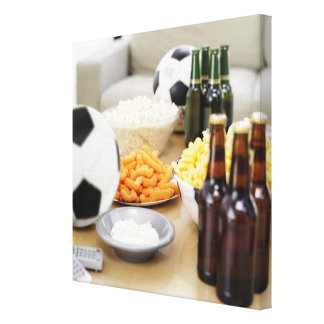 close-up of a remote control with beer bottles canvas print