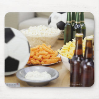 close-up of a remote control with beer bottles mouse mat