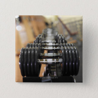 Close-up of a row of dumbbells 15 cm square badge