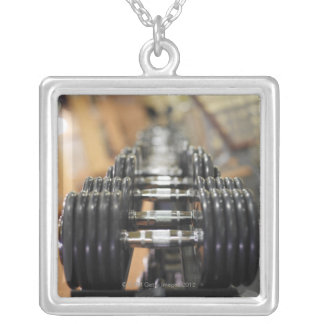 Close-up of a row of dumbbells square pendant necklace