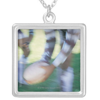 Close up of a Rugby Union Player Passing The Silver Plated Necklace