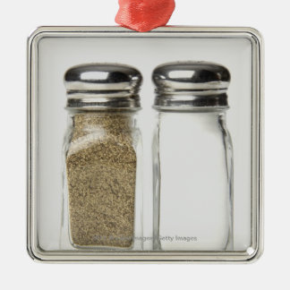 Close-up of a salt and a pepper shaker christmas ornament