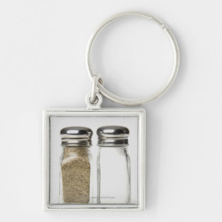 Close-up of a salt and a pepper shaker key ring