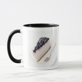 Close-up of a slice of blueberry cheese cake mug