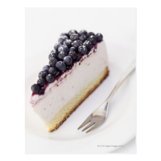 Close-up of a slice of blueberry cheese cake postcard