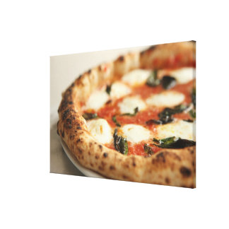 Close-up of a whole pizza pie canvas print