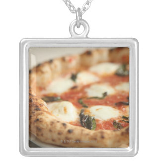 Close-up of a whole pizza pie silver plated necklace