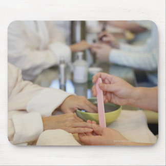 Close-up of a woman s hand getting a manicure mouse pad