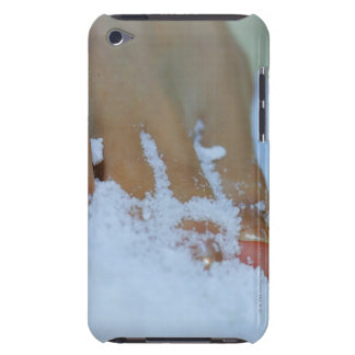 Close-up of a woman's foot in salt barely there iPod covers