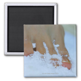 Close-up of a woman's foot in salt square magnet