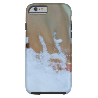 Close-up of a woman's foot in salt tough iPhone 6 case
