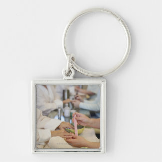 Close-up of a woman's hand getting a manicure Silver-Colored square key ring