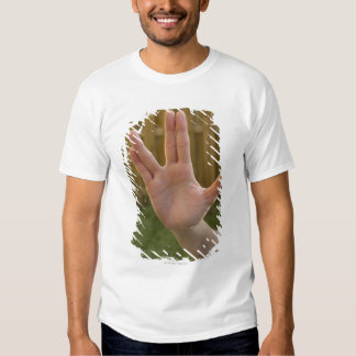 Close-up of a woman's hand making a hand sign t-shirts